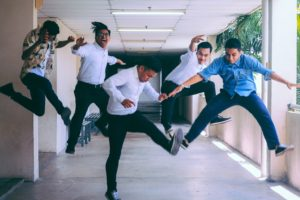 Five guys jumping in the air