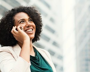 Woman making a phone call and smiling